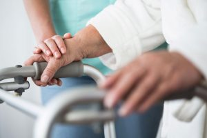 Nurse Helping Senior With Walking